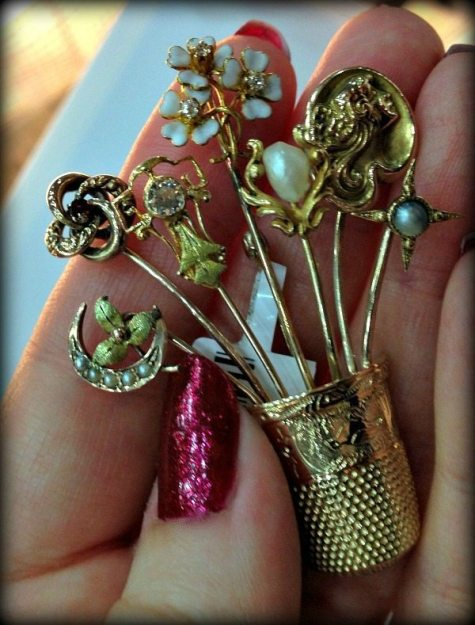 Brooch created with antique gold and diamond stick pins.