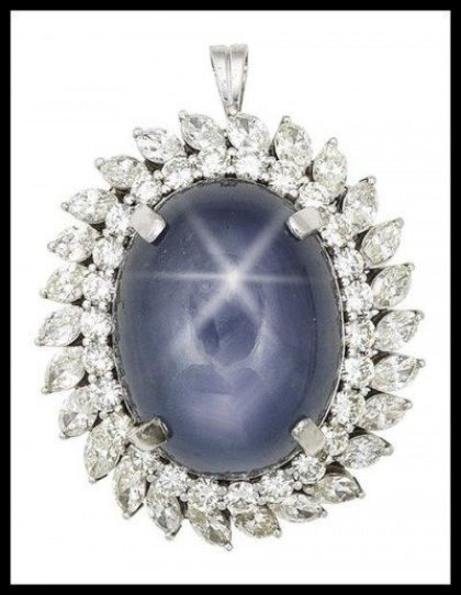 Star sapphire and diamond cluster pendant.