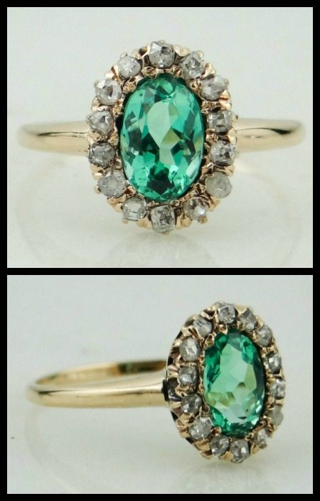 An oval emerald set in an antique gold mounting with rose cut diamonds.