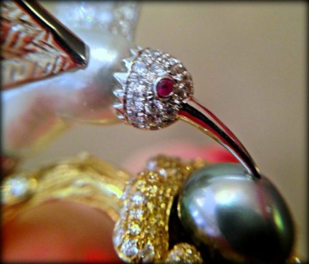 Detail of Emiko Pearls' bird ring, a one of a kind piece featuring Keshi pearls and white and yellow diamonds.