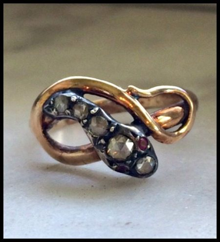 Antique 18k yellow gold and silver snake ring with rose cut diamonds and ruby eyes. Circa 1700s.