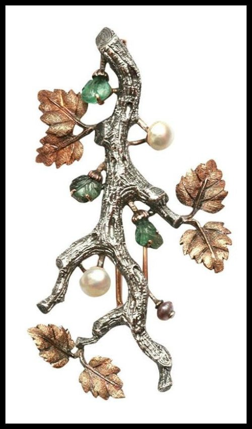 Buccellati white and yellow gold branch brooch with carved emeralds and pearls.