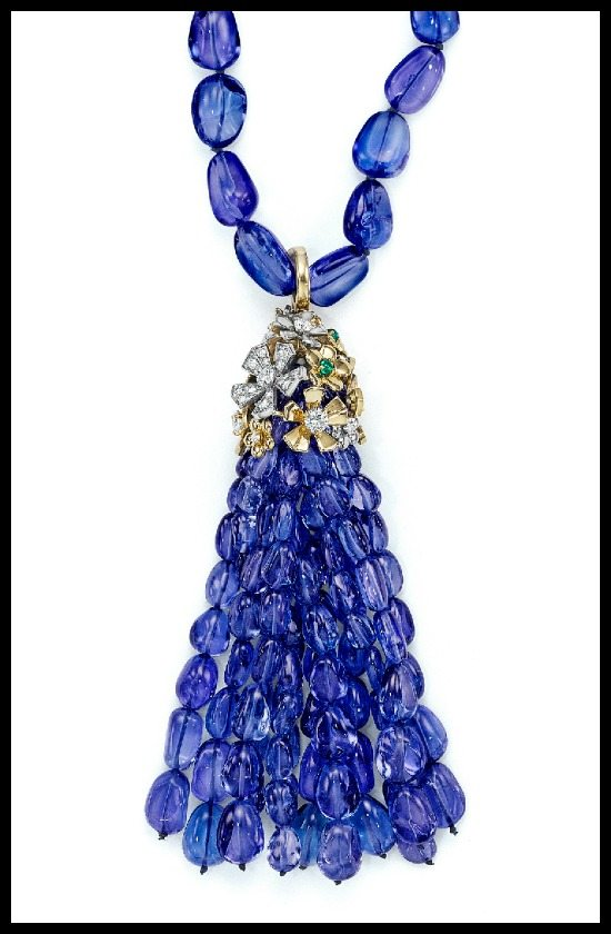 Mimi So Couture tanzanite tassel necklace with emerald and diamond flowers in gold.