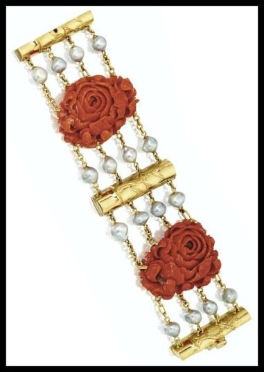 Carved coral, gold, and pearl roses and bamboo bracelet by Seaman Schepps. Via Diamonds in the Library.