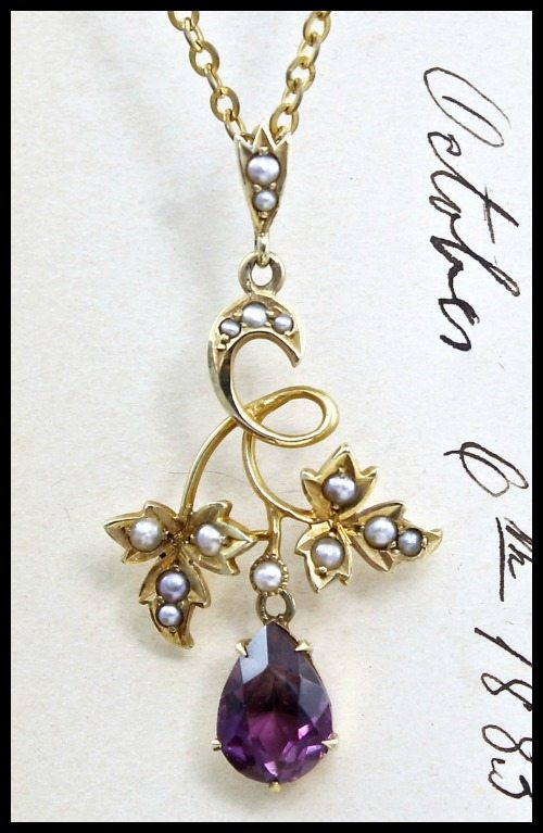 Antique Edwardian lavaliere pendant necklace in rose gold with amethyst and pearls.