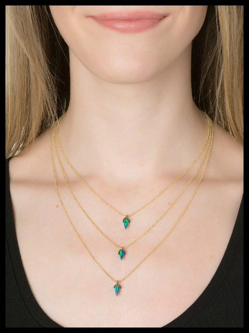 Lionette Avish necklace in blue; 14k gold vermeil-plated with opalescent stones.