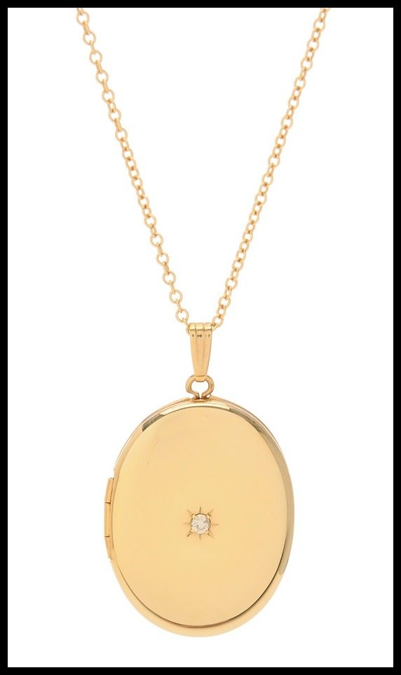 A gold and diamond oval locket by Lori McLean jewelry.