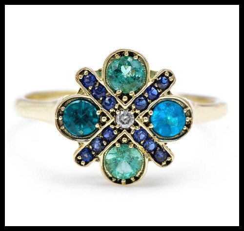 Large Paraiba Flower ring by Lori McLean with paraiba, sapphire, and diamond in 14k green gold.