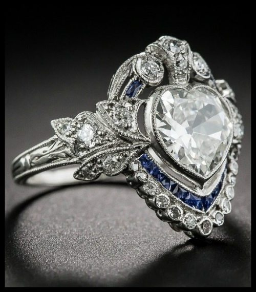 Shoulder view of Edwardian sapphire and diamond ring with a 1.20 carat heart shaped center diamond.