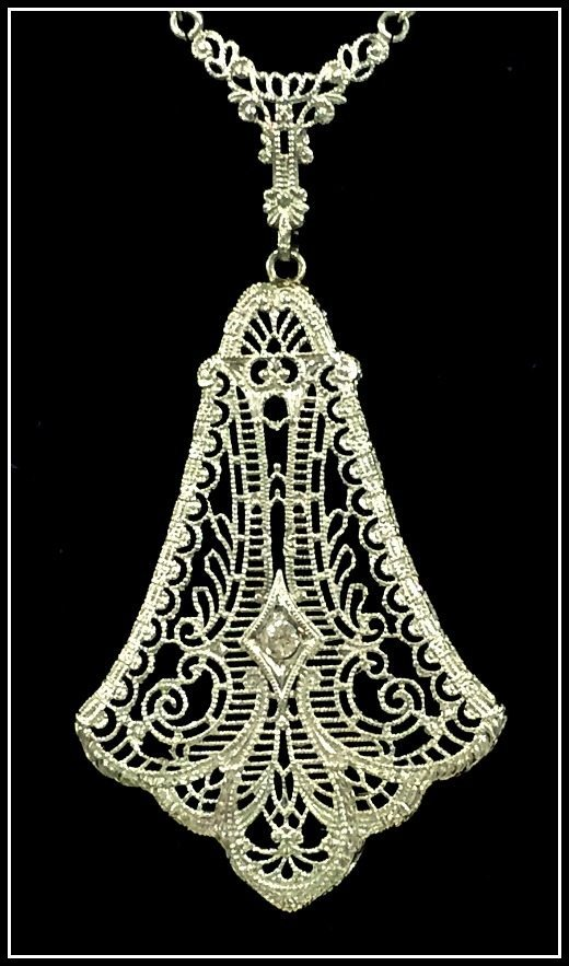 An antique filigree and diamond necklace in white gold.