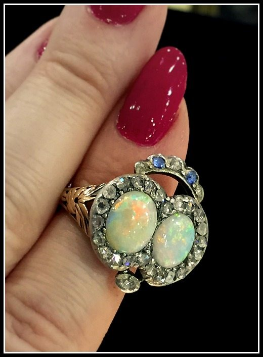 Glorious antique double opal heart ring with diamonds and sapphires in silver and gold.