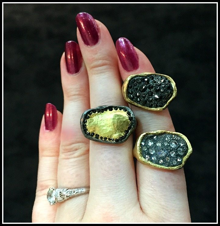 A trio of very cool TAP by Todd Pownell rings with gold and pavillion-up diamonds