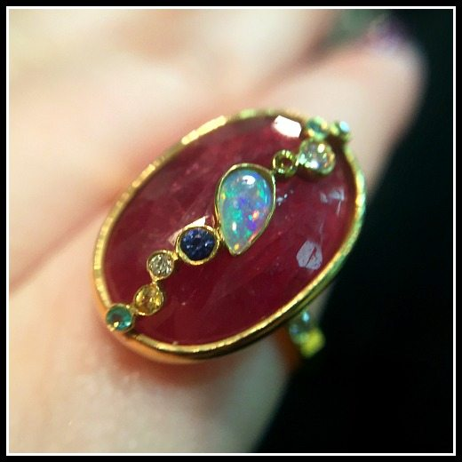 Detail shot of a gemstone ring from Zaiken Jewelry's Throwing Stones collection