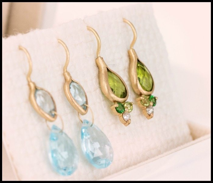 Two pairs of gemstone earrings by Melanie Casey. The earrings on the right are peridot.