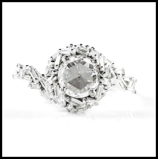 A Suzanne Kalan engagement ring from Devoted collection. 0.64 ct center diamond with 0.90 carats of baguette diamonds surrounding it, set in 18k white gold.