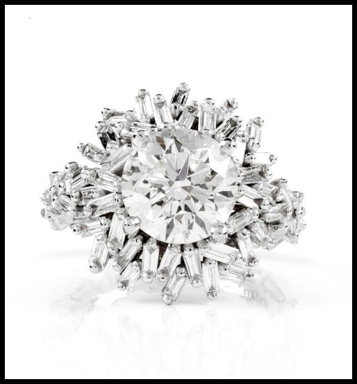 A one of a kind Suzanne Kalan engagement ring the Devoted collection. 3.02 ct center diamond with 1.45 carats of baguette diamonds surrounding it, set in 18k white gold.