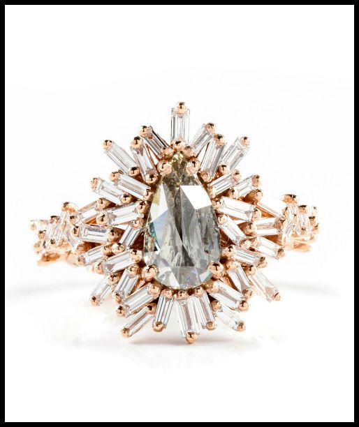 A rose gold engagement ring from Suzanne Kalan's Devoted collection. 1.13 ct center diamond with 1.30 carats of baguette diamonds surrounding it, set in 18k rose gold.