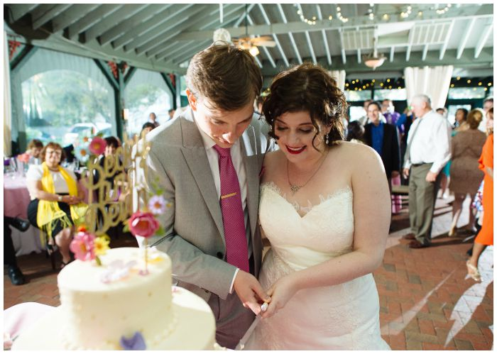 Cutting our beautiful cake! Photography by Angel Kidwell.