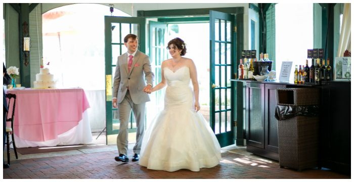 Entering our reception as husband and wife! Photography by Angel Kidwell.