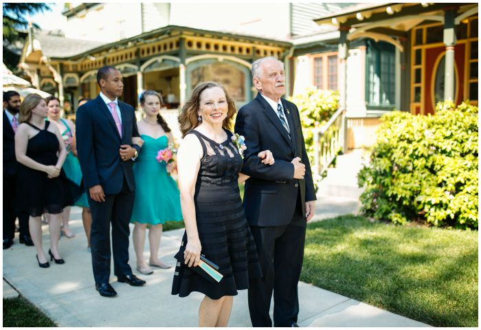 Parents of the groom ready to lead us down the aisle. Photography by Angel Kidwell.
