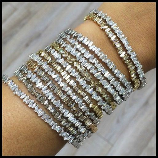 Stunning baguette diamond bangles by Suzanne Kalan. Good solo, crazy amazing all together.