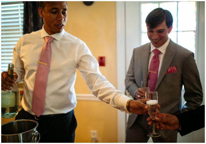 The groomsmen toasting before our ceremony at the Vandiver Inn. Photography by Angel Kidwell.