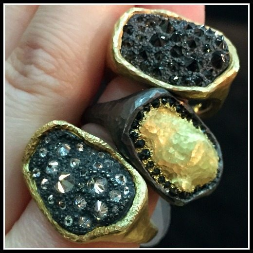 Three extremely cool TAP by Todd Pownell rings with gold and pavillion-up diamonds