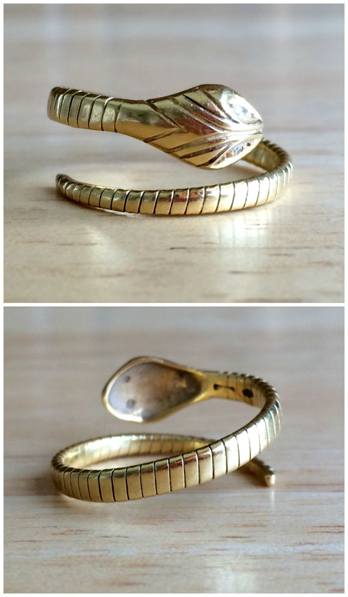 A yellow gold and diamond snake ring from Erie Canal Collectors. Vintage, circa 1960's.