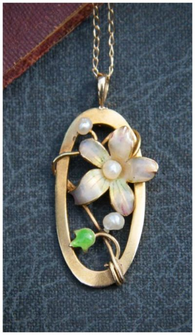 This lovely gold and enamel Art Nouveau pendant is currently up for grabs in my giveaway! Be sure you don't miss your chance to enter.