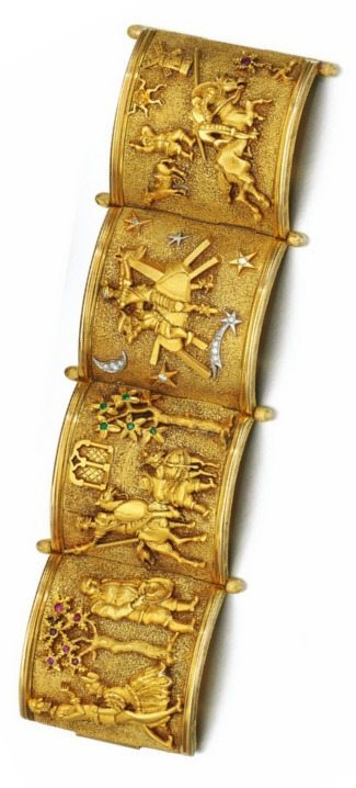 A fabulous bracelet from the 1950's that shows the scenes from the story of Don Quixote. Vertical view.