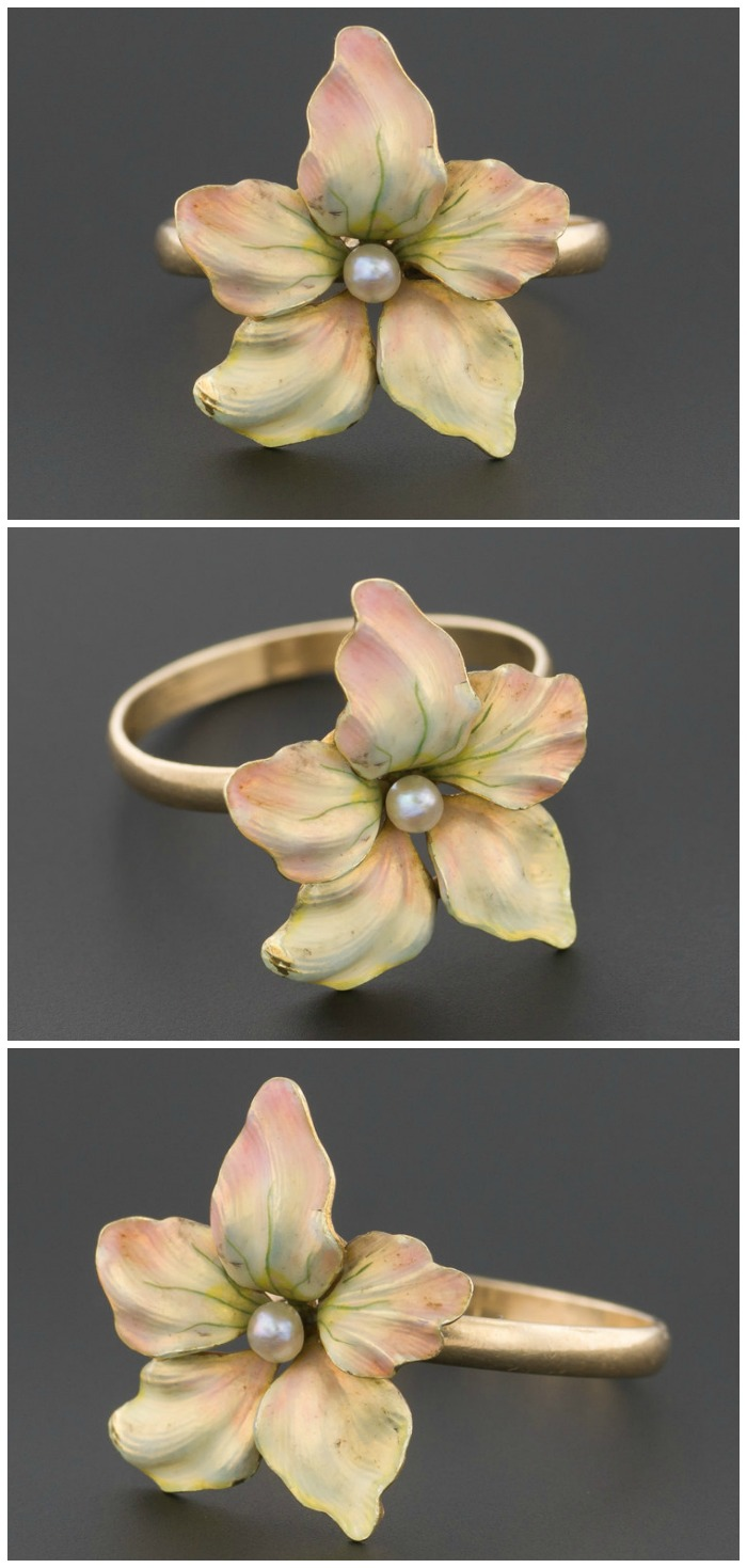 A ring made from a converted antique enamel flower pin with a pearl center.