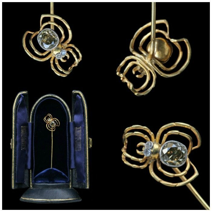 An antique Art Nouveau spider stickpin in gold with diamond eyes and body. From Tadema Gallery.