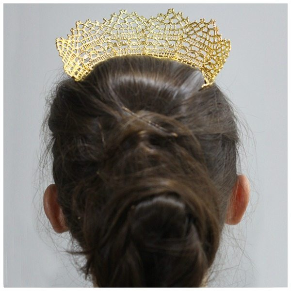 Back view of a beautiful gold lace tiara by Monika Knutsson. This piece is made from actual antique lace dipped in 24k gold.