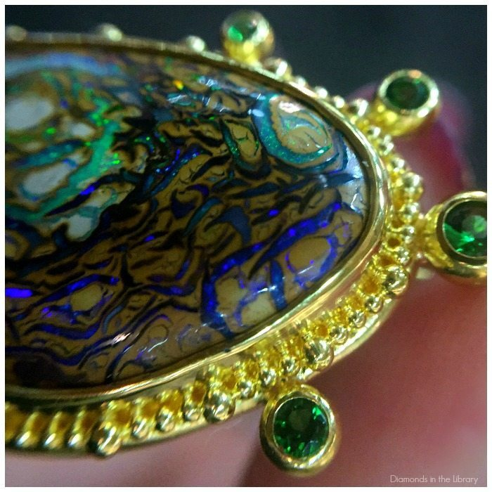 Detail of a remarkable opal earrings from Zaffiro Jewelry