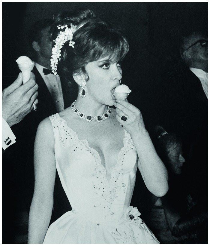 Gina Lollobrigida enjoying an ice cream cone in her Bulgari emeralds and diamonds at the Monaco Centenary Ball in 1966.