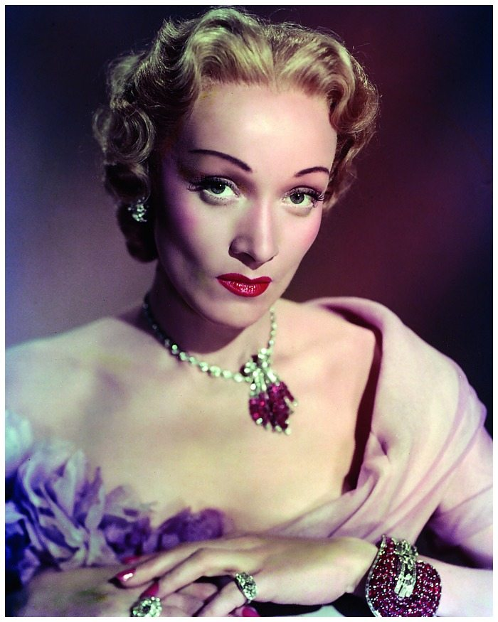 Marlene Dietrich wearing her own jewels in the 1950 film, Stage Fright. Most notable is her Van Cleef and Arpels Jarretière bracelet.
