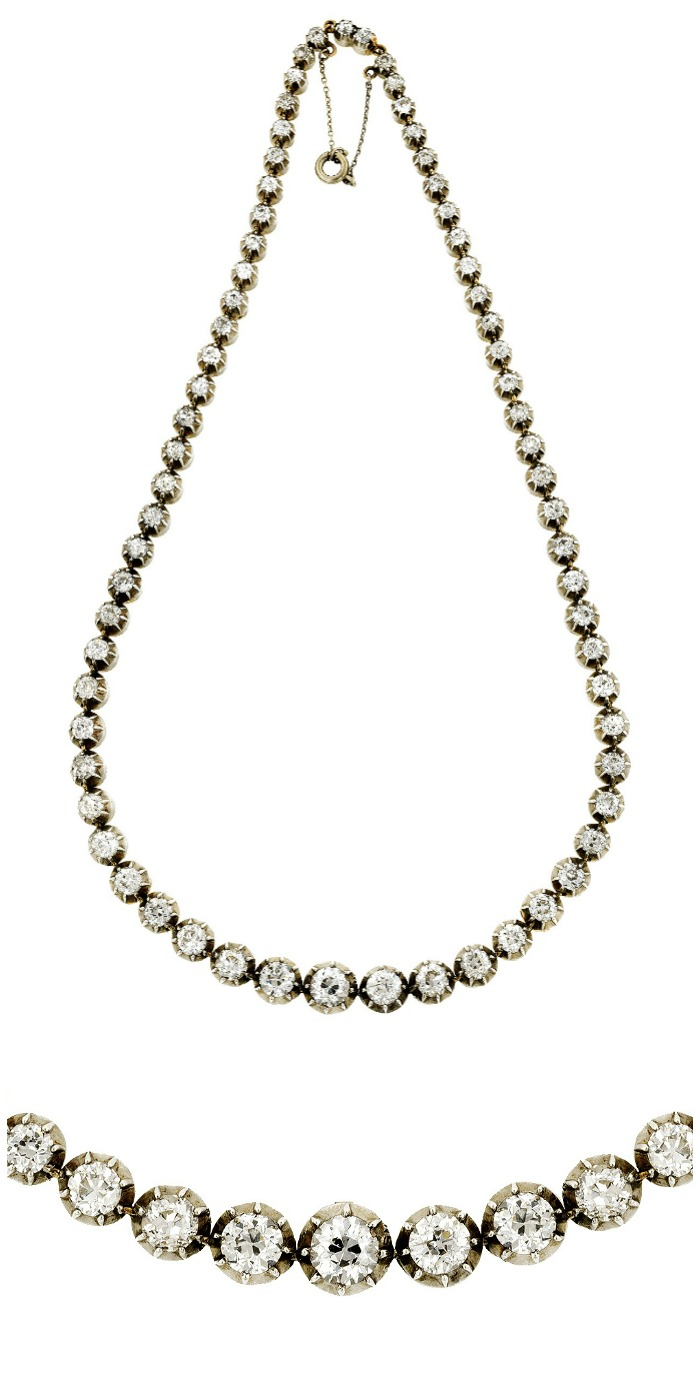 An antique Victorian riviere necklace featuring 15.60ctw of Old European cut diamonds in cut down collet settings. Fashioned in silver and 10k gold, circa 1880.