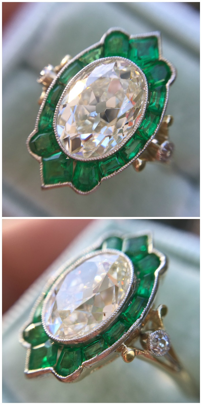 Antique 2.12 carat oval diamond ring with amazing emerald halo. In box.