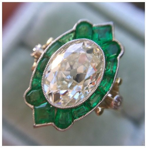 Antique 2.12 carat oval diamond ring with amazing emerald halo.