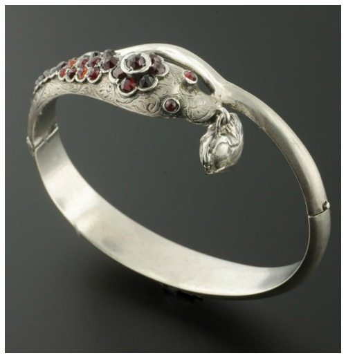 Antique Victorian snake bangle in sterling silver with garnets.