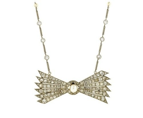 Antique diamond and pearl stylized bow convertible necklace. French, circa 1910. Becomes two bracelets and a brooch.