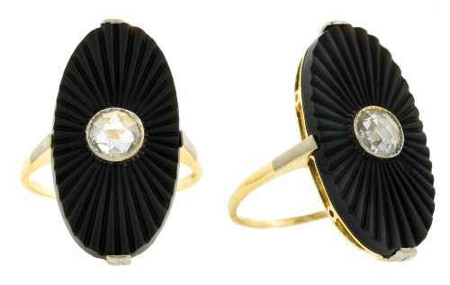 Art Deco Onyx and Rose Cut Diamond Ring in 14k gold. Bezel set Rose cut diamond in a carved, fluted oval onyx. Circa 1935.