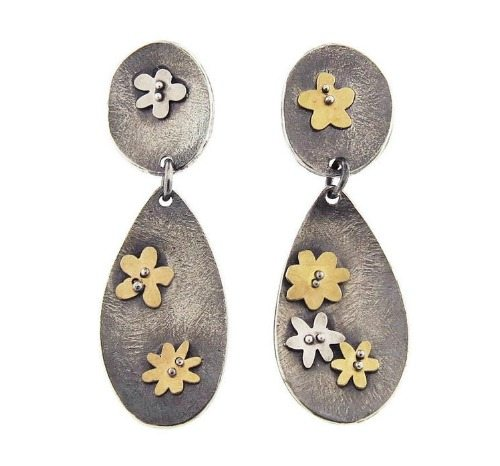 Himatsingka Buttercup double drop earrings. With 22 karat yellow gold and sterling silver flowers against double drops of oxidized sterling silver.