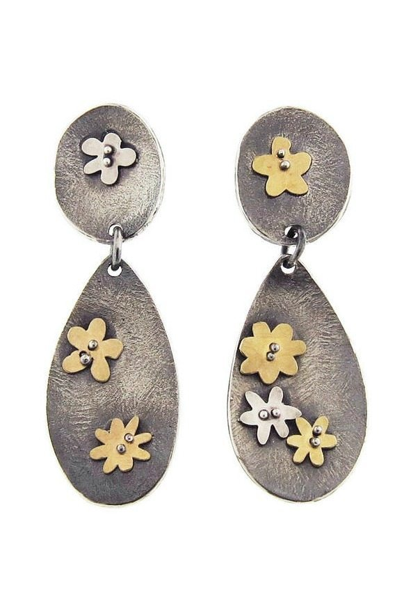 Himatsingka's Buttercup double drop earrings. With 22 karat yellow gold and sterling silver flowers against double drops of oxidized sterling silver.