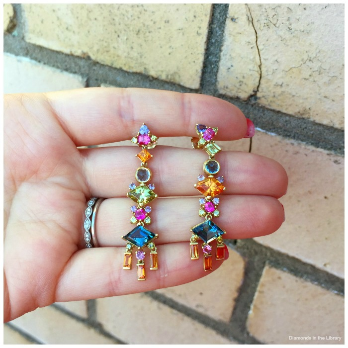 Jane Taylor's Freida Kahlo earrings with aquamarines, spessartite garnets; pink, purple, and orange sapphires; pink tourmaline; green diamonds, and Mali garnets.