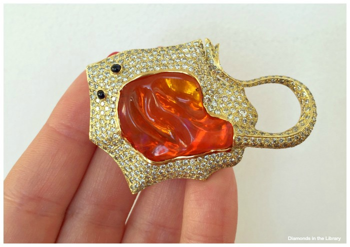 Pamela Huizenga stingray brooch with a 14.56 carat Mexican fire opal with diamonds and blue sapphires.