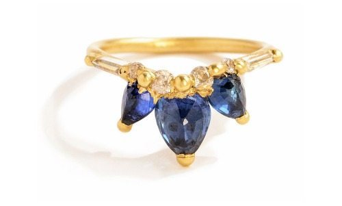 The Polly Wales Fleur de Lys sapphire halo V ring in yellow gold with diamonds.