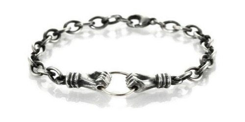 Workhorse Una bracelet in sterling silver with hands clasping a ring.