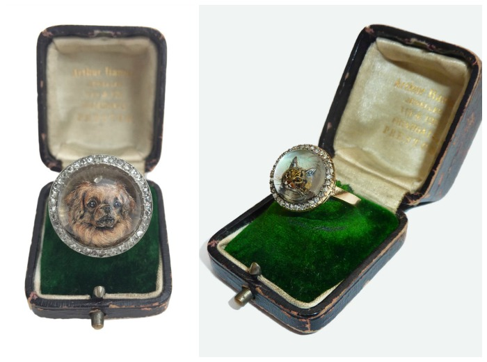 Two remarkable rings featuring antique reverse painted crystal intaglios - one cat, and one dog. At Antique Animal Jewelry.