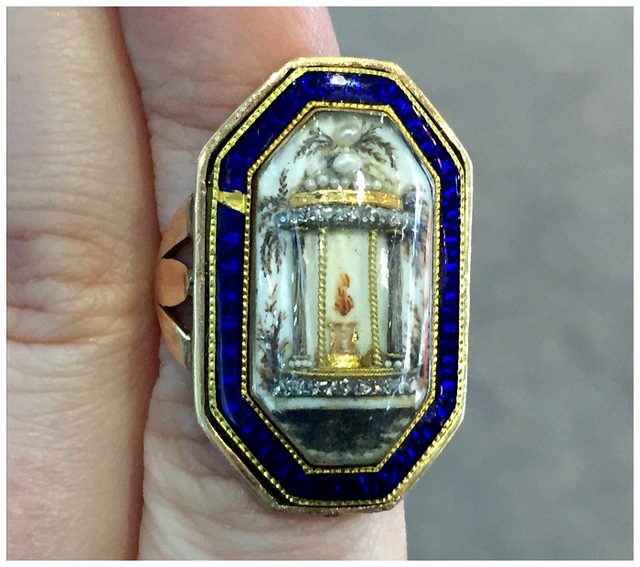 A remarkable antique Georgian ring with a 3 dimensional motif of a classical temple and a flame. At Micheal Longmore.